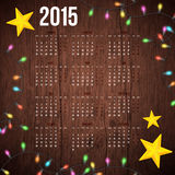 2015 year calendar. Wooden background, realistic garland and decorative stars with 2015 year calendar. Vector illustration Royalty Free Stock Photography