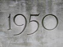 1950, Year Carved In Stone. 1950 year carved stone mid middle century etched fifty nineteen 50s 1950s half cornerstone years number numbers stones stonework stock photo