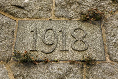 Year 1918 carved in stone. The years of World War I. Stock Photos