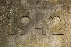 Year 1942 carved in stone. The years of World War II. Stock Images