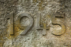 Year 1945 carved in the stone. Years of World War II. Stock Photos