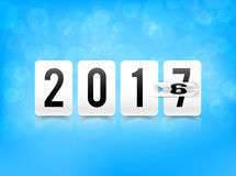 Year change from 2016 to 2017 with paper flip and number element. On bokeh and lighting effect background vector illustration eps 10 Royalty Free Illustration