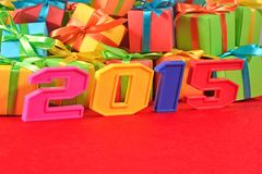 2015 year colorful figures on the background of gifts Stock Photos