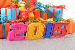 2015 year colorful figures on the background of gifts Royalty Free Stock Images