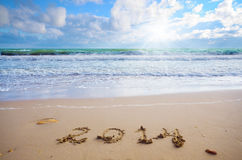 Year 2014 coming concept on beach Royalty Free Stock Photography