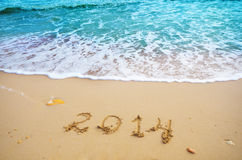 Year 2014 coming concept on beach Royalty Free Stock Photos