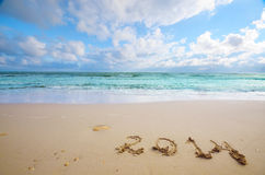 Year 2014 coming concept on beach Stock Image