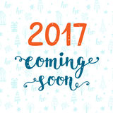 2017 year coming soon. Modern unique hand lettering in red and blue colors. Christmas hand-drawn doodles. Trendy typography design for placards, posters Royalty Free Stock Images