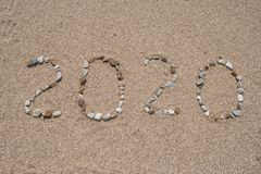 2020 Year written on the beach sand stock photography
