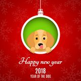 2018 year of the dog. Paper clippings. Advertising banner. Christmas ball of paper. Cartoon dog peeks out of the hole. White text. Snowflakes on a red Royalty Free Stock Images