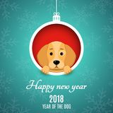 2018 year of the dog. Paper clippings. Advertising banner. Christmas ball of paper. A cartoon dog peeks out of the hole. White tex. T. Snowflakes on a blue Stock Images