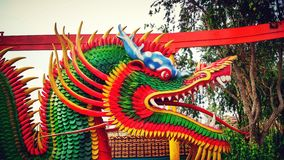 The year of the Dragon. Photo from a mobile camera of an amusement park dragon ride Royalty Free Stock Photos