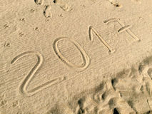 Year 2017 drawn in the sand Stock Images