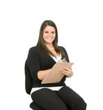 Year End Inventory. Pretty young woman with clipboard on white background.  Taking inventory, checking checklist Royalty Free Stock Images