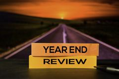 Year End Review on the sticky notes with bokeh background