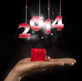 Year 2014. A gift box with year 2014 on black background Royalty Free Stock Image