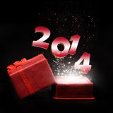Year 2014. A gift box with year 2014 on black background stock photos