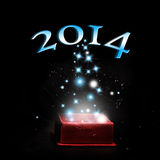 Year 2014. A gift box with year 2014 on black background Stock Image
