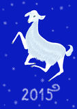 2015 Year of the Goat. 2015 goat on a blue background with snowflakes Stock Illustration
