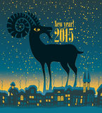 Year of the goat. Christmas card with a goat on a background of night city Stock Photo