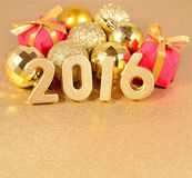 2016 year golden figures and Christmas decorations Stock Image