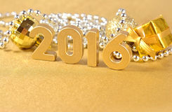 2016 year golden figures and Christmas decorations Royalty Free Stock Images