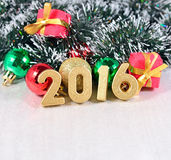 2016 year golden figures and Christmas decorations Stock Photography