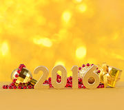 2016 year golden figures and Christmas decorations Royalty Free Stock Photo
