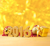 2016 year golden figures and Christmas decorations. 2016 year golden figures on the background of Christmas decorations stock illustration