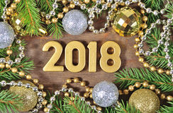 2018 year golden figures and Christmas decorations Royalty Free Stock Photography