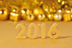 2016 year golden figures and golden Christmas decorations Stock Photo