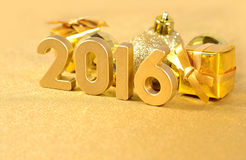 2016 year golden figures and golden Christmas decorations Royalty Free Stock Images