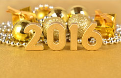 2016 year golden figures and golden Christmas decorations Royalty Free Stock Photos