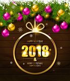 2018 year golden figures on a spruce branch Royalty Free Stock Images