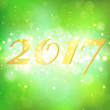 Year 2017 on green bokeh abstract background Stock Photo