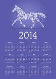 2014 Year of Horse calendar. With horse-shape snowflake mosaic on а blue background Stock Images