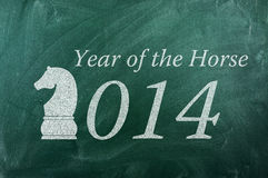 2014 year of the Horse. On green ghalkboard stock illustration