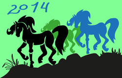 Year of the horse. Image of silhouettes of three beautiful horses, with the characters figure in 2014 Royalty Free Stock Photo