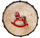 Year of the Horse- red color rocking horse on a drum surface, view from above stock photos