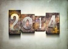 Year 2014 letterpress. The word 2014. Random letterpress type on grunge background Royalty Free Stock Image