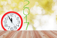 2017  year made from green leaves and red alarm clock showing fi Stock Image