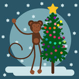 Year of the monkey. monkey with a tree. On a snowy background Royalty Free Stock Photos
