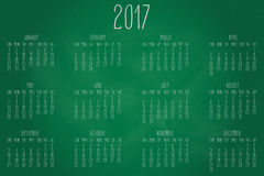 Year 2017 monthly calendar. Hand written calendar for the year 2017 over green chalkboard background vector illustration