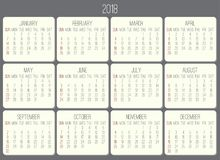 Year 2018 monthly calendar. Year 2018 plain contemporary vector monthly calendar. Week starting from Sunday. Beige rounded rectangle over gray background Royalty Free Stock Photos