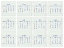 Year 2017 monthly calendar. Year 2017 vector monthly calendar on a ruled notebook pages. Week starting from Sunday. Hand written typography Stock Illustration