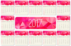 Year 2017 monthly calendar. Year 2017 vector monthly calendar. Week starting from Sunday. Contemporary low poly design in hot pink color Stock Images