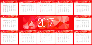 Year 2017 monthly calendar. Year 2017 vector monthly calendar. Week starting from Sunday. Contemporary low poly design in red color Stock Images