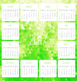 Year 2017 monthly calendar. Year 2017 vector monthly calendar. Week starting from Sunday. Contemporary low poly design in vibrant green color Royalty Free Stock Photos