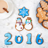 2016 year near snowmen and other gingerbreads Stock Image