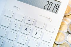 Number 2019 display on calculator with tax button royalty free stock image